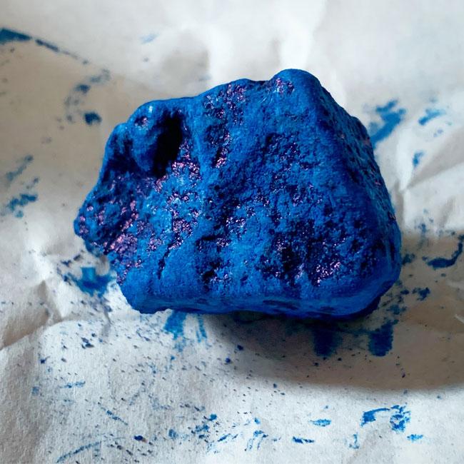 indigo blue pigment, like a rock